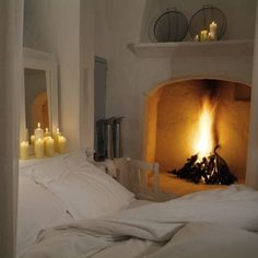 31 Epic Fireplaces For The Ultimate Snow Day - candles & fireplace
