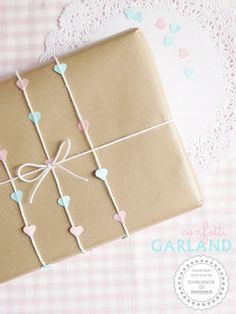 Brown paper wrapping with Pastel hearts on string