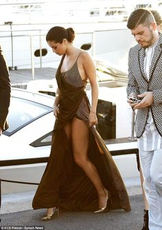 If you've got it: Selena flashed her toned legs in the frock, which sported a hip-high sli...