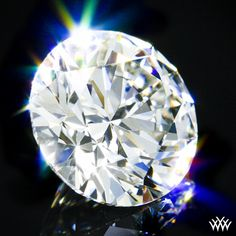 1.514 carat F color VS2 clarity A CUT ABOVE® Hearts and Arrows Super Ideal Round Cut Loose Diamond - Hearts and Arrows Ideal Proportions and a AGS Diamond Report. Price $22,448 www.whiteflash.com