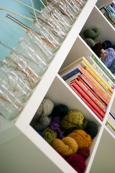 Line up some mason jars and #organize your #knitting needles in ascending order, by size.