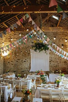 Festival Barn Wedding A charming festival DIY style barn wedding with pastel bunting, fairy lights and vintage, rustic touches.A charming festival DIY style barn wedding with pastel bunting, fairy lights and vintage, rustic touches. Wedding Bunting, Barn Wedding Decorations, Wedding Flowers, Decor Wedding, Wedding Rustic, Festival Decorations, Weding Decoration, Diy Wedding Garland, Romantic Decorations