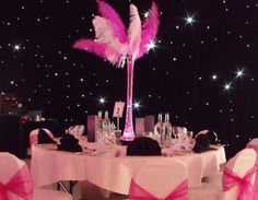 Google Image Result for http://www.table-centres.co.uk/assets/images/table-centres/lily-vase-with-feather-plumes-tablecentre-l.jpg