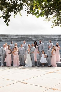 A blush and grey themed wedding at First Landing State Park in Virginia Beach photographed by Caitlin Gerres Photography.