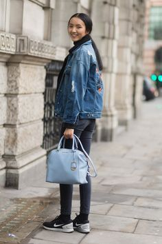 Pin for Later: The Top Models Buddied Up on the Last Day of MFW LFW Day Two Luping Wong wearing Nike sneakers and a Michael Kors bag