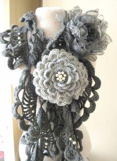 Long sea shells  crochet scarf  in dark gray with a gray organza flower brooch and a light gray  crochet rose brooch. $32.99, via Etsy.