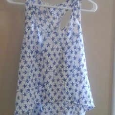 High low tank top Cute white racer back tank top, high low, with blue stars. Very see through, should be worn with a tank or cute bandeau! one clothing Tops Tank Tops
