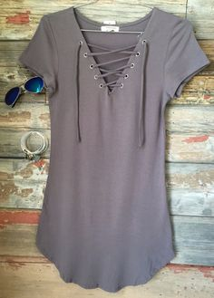 The Fun in the Sun Tie Dress in Slate is comfy, fitted, and oh so fabulous! A great basic that can be dressed up or down! We love the added detail of the tie front! Sizing: Small: 0-3 Medium: 5-7 Larg