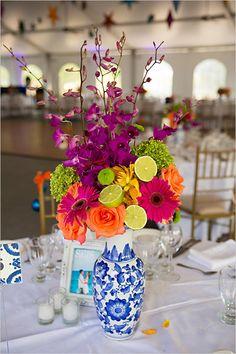 I love this vase! Beautiful festive florals http://www.weddingchicks.com/2013/01/29/fiesta-inspired-wedding/