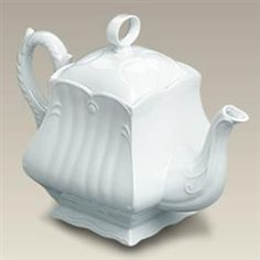 """Treat your guests with tea poured from this elegant square French country style teapot. The 7"""" high 46 ounce pot had a classic loop knob and embossed ridges and scroll-work.  Made in China.  Dishwasher and microwave safe."""