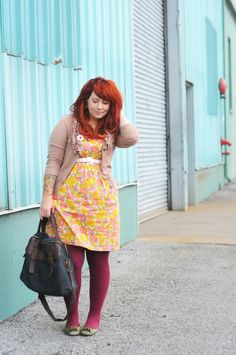 I adore vintage dresses, and the working of the tights to match the hair colour is brilliant.  Utterly gorgeous styling.