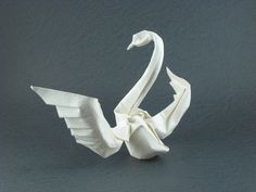 Origami Swan by Hoang Tien Quyet Wet-folded from a triangle of watercolor paper by Gilad Aharoni on www.giladorigami.com