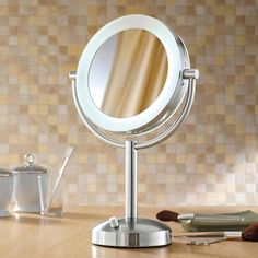 10X/1X Natural-Light Tabletop Makeup Mirror - Our 10X/1X Natural-Light Makeup Mirror helps you see better—to look your best.  The combination of a dimmable, daylight spectrum, fluorescent light bulb that simulates natural sunlight, and an optical quality mirror, gives you the most natural, glare-free, distortion-free image possible.