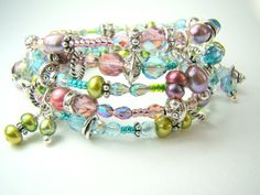 Crystal wrap bracelet, wrapped pearl charm bracelet, pastel bracelet... THATS A WRAP (in pastel) by strandsofgrace on Etsy https://www.etsy.com/listing/101589540/crystal-wrap-bracelet-wrapped-pearl