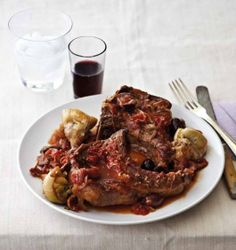Pork Chops Provençal - Provençal cooking brings the flavors of France and the Mediterranean together. Pork is simmered in a sauce rich with the flavors of vegetables, bacon, and fennel. Slow cooking melds the flavors for a perfectly seasoned dish.