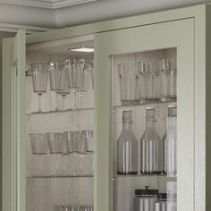 Pale enough to work as a neutral, the sage green tone of these sturdy, 20mm-thick doors makes a great choice for those that want a subtle style with plenty of country character. Choose from a wide variety of cupboards, such as larder units, which can keep cooling devices hidden from view to help maintain an uninterrupted design. Green Kitchen Cabinets, Kitchen Doors, Cupboard Doors, Kitchen Cabinet Design, Home Decor Kitchen, Home Kitchens, Cupboards, Shaker Style Doors, Shaker Doors