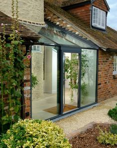 A beautifully designed extension to a listed cottage in Oxfordshire, featuring structural glass walls, a shaped structural glass roof and a Schueco single casement door. Cottage Extension, House Extension Design, Glass Extension, House Design, Porch Extension, Glass Porch, Glass Roof, Brick Cottage, Rustic Cottage