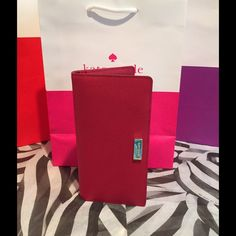 Kate Spade Stacy Newbury Lane Snap Wallet 100% Authentic.  Dynastyred saffiano leather.  14-karat gold plated hardware.  Interior features clear slot for ID, 12 credit card slots, 4 long bill slots, and snap closure.  Outside zip pocket. kate spade Bags Wallets