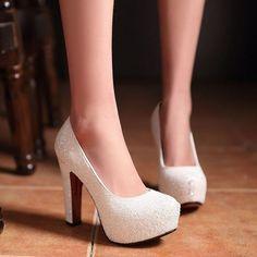Stunning Silver Glitter High Heels Pumps Gender: Women Item Type: Pumps Shoe Width: Medium(B,M) Process: Adhesive Season: Spring/Autumn With Platforms: Yes Closure Type: Slip-On Toe Shape: Round Toe i