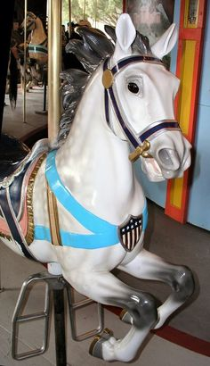 The c.1905 Dentzel Carousel at Watkins Regional Park in Upper Marlboro, MD. Muller Third Row Jumper. Again, love the mane and he's beautifully decorated for a third row horse.