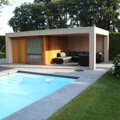 poolhouse de jardin - maison bois. Un abri de jardin haut de gamme. Poolhouse moderne - maisons bois - cote terrasse