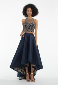 Brooklyn & Bailey's Picks! Own the dance floor in this formal evening gown! The features of this prom dress include a two piece dress style, illusion neckline, metallic appliqué crop top, and a high-low skirt. Pair it with multi strap heels, teardrop earrings, and a gold clutch to finish. #camillelavie