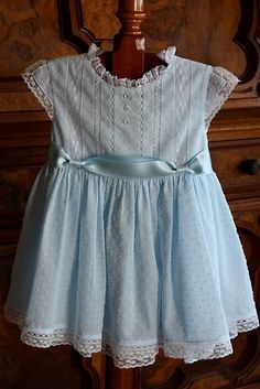 "What a beautiful dress!  - Pattern:  The Bodice Dress by Collars, Etc. Pattern Company.  Fabric:  Bear Threads blue hailspot voile for dress; blue swiss voile for slip.  Laces:  Bear Threads' french malines - 3/8"" beading, 1/2"" insertion, 1 1/8"" insertion, 5/8"" edging, 1"" edging; Capitol Imports' white baby entredeaux."
