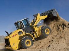 New Holland Construção - Pás Carregadeiras W190B - A Pá Carregadeira W190B da New Holland foi projetada para trabalhos pesados, movendo mais material por hora proporcionando a máxima produtividade