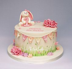 Bunny and Bunting Birthday Cake | Flickr - Photo Sharing! A cute 1st Birthday cake with sugar roses, bunting, bunny, blossoms and butterflies with hand painted grasses around the base of the cake. www.jellycake.co.uk