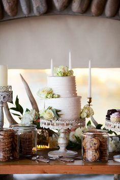 Elegant wedding cake idea - two-tiered wedding cake with white buttercream-frosting and ivory flowers {Todd Nichols Photography}