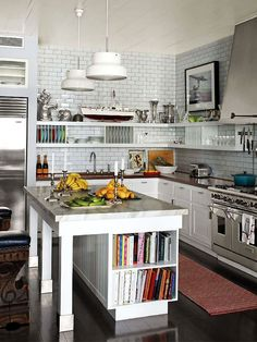 I love the white tile backsplash, and cabinets with the dark countertop and stainless appliances. I think seeing everything is functional and yet doesn't look cluttered.