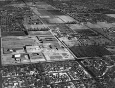 Campus of San Fernando Valley State College (now CSUN), aerial view looking north, about 1960. Nordhoff Hall, the Music Building on the left; Science buildings 1 and 2 and Bookstore Complex in the center.