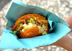 Brazilian Acaraje. Also found in Nigeria, this Brazilian Black-eyed Pea fritter is a popular snack in this City, especially for the beach bums. This little fritter is usually served, split in half, and then filled with spicy pastes made from shrimp, cashew nuts, and palm oil. The traditional ingredient in Acaraje is dried shrimp but because of its strong flavor, they came up with a mild version of the filling by using fresh shrimp and caramelized onions as alternatives.