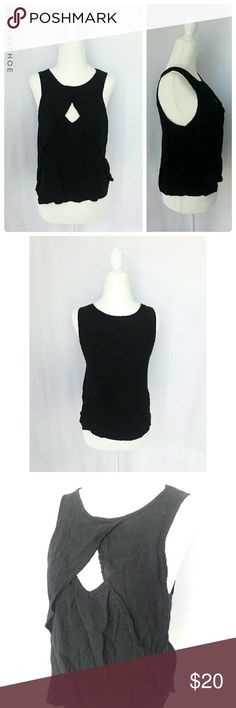 "{free people} keyhole flowy top A beautiful black sleeveless tank top with a flowy front and a subtle sexy ""cutout"" look.  Pair with shorts and leather sandals for a casual yet chic look.  From Free People.  Gently worn.  Size small. Vicose/rayon. Length ~21""  Mannequin measurements: 33"" bust, 26"" waist, 35"" hips Free People Tops Tank Tops"