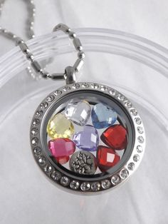 """Our small """"Jar of Hearts"""" Family Floating Charm Locket Necklace now includes a sweet tree of life/family tree charm!  Add the birthstones of your loved ones for a cherished gift for yourself or someone special."""