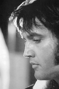 """""""Elvis may have been the the most beautiful man in the world. His face was carved like a stone, chiseled out of rock, he was just that good looking and his voice was unbelievable!""""  - Waylon Jennings"""