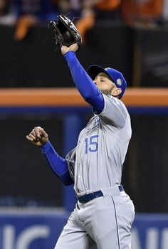 Kansas City Royals right fielder Alex Rios caught a sacrifice fly hit by New York Mets right fielder Curtis Granderson in the third inning but hesitated to throw it in to home to prevent a run during game four of the World Series on Saturday, October 31, 2015 at Citi Field in New York.