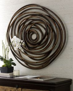 """Wooden Swirl"" Wall Decor at Horchow.Rattan has a dark coffee finish. Variations are due to handcrafting. Includes metal hanger for mounting.  Approximately 44""Dia. x 2.5""D."