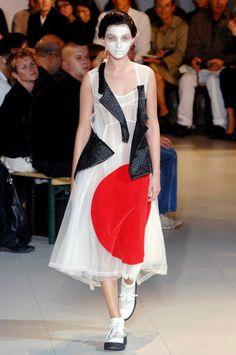 Rei Kawakubo / Comme des Garçons  Spring/Summer 2007  White triacetate/polyester tulle dress with black nylon appliqué  and red rayon flock print with hinomaru (rising sun) motif.