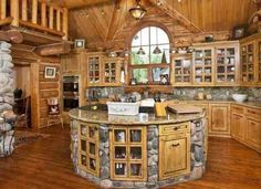 Love the island. Awesome kitchen style.