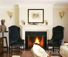 Photo Gallery: Classic French Style   House & Home  Classic Chic Living Room  White and warm designer style.  Montreal designer Julie Charbonneau created the great bones of this space - period perfect oak flooring, deep mouldings and a new fireplace - then decorated with living room furniture that complements the traditional but comfortable feel of the rest of her home's decor. Velvet linen wing chairs and gold sconces pump up the luxurious look.