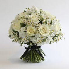 A timeless and classic combination of finest large-headed white roses blended with phlox, matricaria and seasonal foliage. The perfect gift for any occasion!