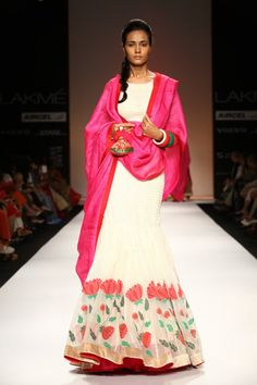 Gaurang Shah outfit. White floor-length anarkali with floral design and pink dupatta. Pink flowers and green leaves.