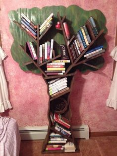 My tree bookshelf that my boyfriend made.