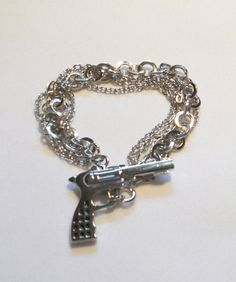 Silver Chain and Handgun Bracelet by TheSterlingCat on Etsy, I don't know if I would wear it but it makes me think of Bonnie and Clyde the musical