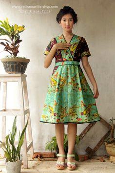 batik amarillis's primavera dress The design offers a chic take on pinafore…