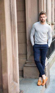 This combination of a grey crew-neck jumper and navy chino pants is perfect for off-duty occasions. A pair of orange leather driving shoes will seamlessly integrate within a variety of outfits.   Shop this look on Lookastic: https://lookastic.com/men/looks/grey-crew-neck-sweater-navy-chinos-orange-leather-driving-shoes/20909   — Grey Crew-neck Sweater  — Navy Chinos  — Orange Leather Driving Shoes