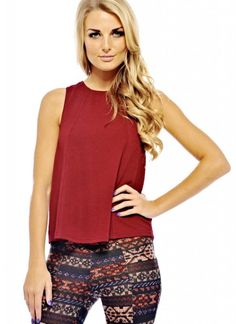 Get this seasons  style by slipping on this stretch knit fabric  top. Perfect for working showstopping style, this trend stopping blouse is a must have.  TW317BUR-G4
