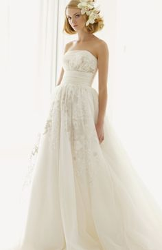 Melissa Sweet for David's Bridal: I would love this dress with loosley curled/up-swept hair. Perfect for a fall wedding. (: