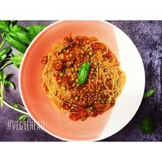 Lentil and pea bolognese...So easy!  Sauté one onion.  Add 2 cups of dried green olentils.  Add 2 tins BPA free organic tommies and 2 cups water.  Bring to a boil then simmer for 35-40 mins or until lentils are tender.  Add more water if needed.  Add 1 cup peas salt to taste and 1 tsp dried basil.  Cook pasta of choice until just al'dente then add to the sauce. Add torn basil and combine.  Like this?  There's hundreds of delicious recipes at buff.ly/2cAjmYt  Don't forget to join the VH party…